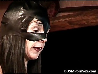 Dominating brunette mistress in black