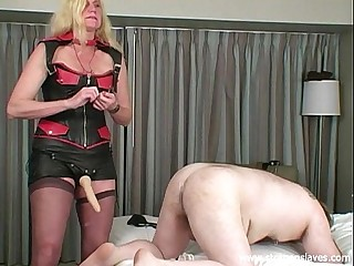 Strapon slave training by blonde Amazon